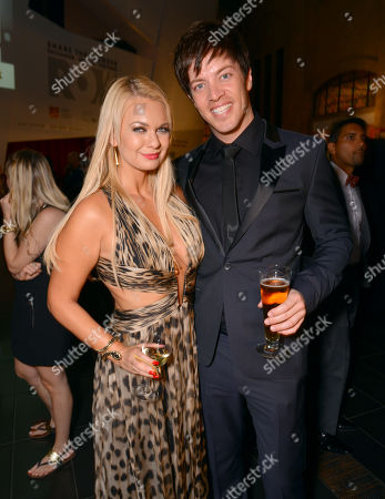 Angeline-Rose Troy, left, and J.D. Scott attend the Producers Ball at the Royal Ontario Museum, in Toronto