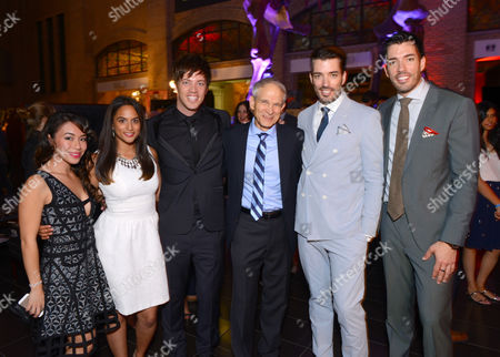 World Vision Canada's Alicia Pereira, second from left, and Dave Toycen, center right, and from left, Linda Phan, J.D. Scott, Jonathan Scott and Drew Scott attend the Producers Ball at the Royal Ontario Museum, in Toronto
