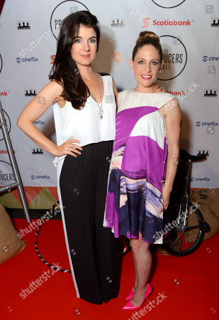 Gabrielle Miller, left, and Tara Spencer-Nairn attend the Producers Ball at the Royal Ontario Museum, in Toronto