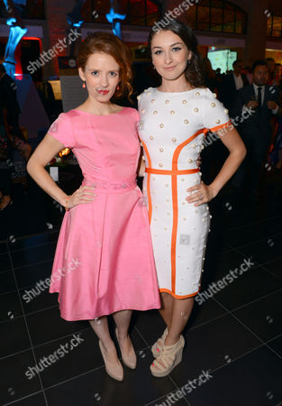 Stock Image of Lara Jean Chorostecki, left, and Ann Pirvu attend the Producers Ball at the Royal Ontario Museum, in Toronto