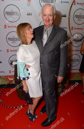Stock Image of Debra McGrath, left, and Colin Mochrie attend the Producers Ball at the Royal Ontario Museum, in Toronto