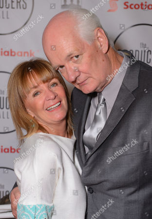 Debra McGrath, left, and Colin Mochrie attend the Producers Ball at the Royal Ontario Museum, in Toronto