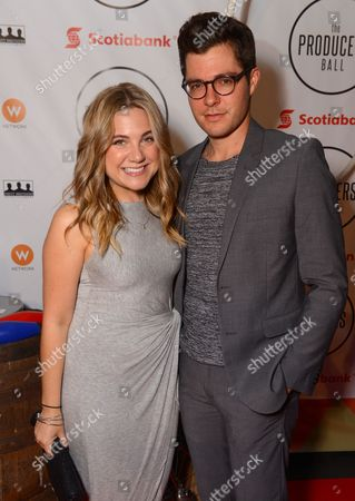 Lauren Collins, left, and Ben Lewis attend the Producers Ball at the Royal Ontario Museum, in Toronto