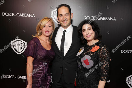 Federica Marchionni, President of Dolce & Gabbana Inc. USA, Greg Silverman, President of Creative Development and Worldwide Production at Warner Bros. Pictures and Sue Kroll, President of Worldwide Marketing and International Distribution at Warner Bros. Pictures seen at Warner Bros. Pictures/Dolce&Gabbana cocktail party hosted by Sue Kroll and Greg Silverman at the Toronto International Film Festival, in Toronto