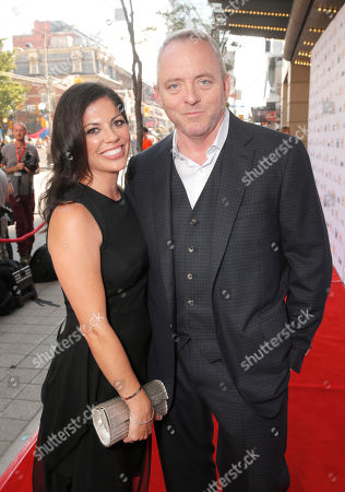 Screenwriter Dennis Lehane (right) and wife attend the premiere of Fox Serachlight's 'The Drop' during the 2014 Toronto International Film Festival at Princess of Wales Theatre on in Toronto, Canada
