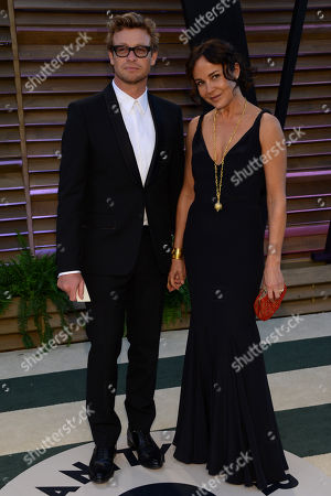 Simon Baker, left, and Rebecca Rigg attend the 2014 Vanity Fair Oscar Party,, in West Hollywood, Calif