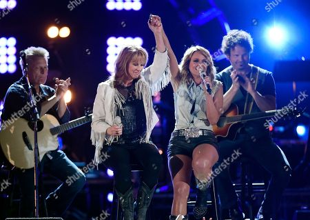 "Patty Loveless, left, and Miranda Lambert perform together at ""ACM Presents: Superstar Duets"" at Globe Life Park, in Arlington, Texas"