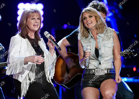 "Stock Photo of Patty Loveless, left, and Miranda Lambert perform together at ""ACM Presents: Superstar Duets"" at Globe Life Park, in Arlington, Texas"