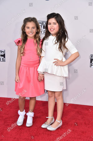 Rosie McClelland, left, and Sophia Grace Brownlee arrive at the American Music Awards at the Microsoft Theater, in Los Angeles