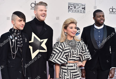 Mitch Grassi, from left, Scott Hoying, Kirstie Maldonado, and Kevin Olusola of Pentatonix arrive at the American Music Awards at the Microsoft Theater, in Los Angeles