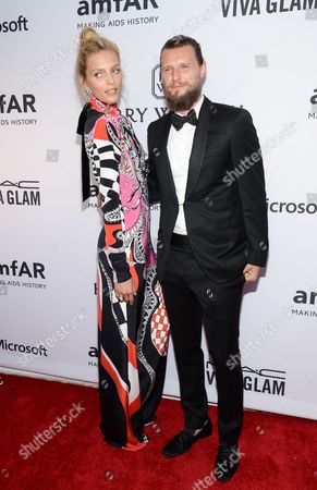 Anja Rubik and Sasha Knezevic attend the 6th Annual amfAR New York Inspiration Gala at Spring Studios, in New York