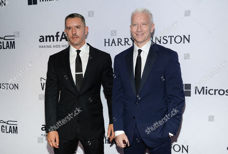 Stock Image of Benjamin Maisani and Anderson Cooper attend the 6th Annual amfAR New York Inspiration Gala at Spring Studios, in New York