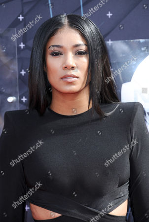 Mila J arrives at the BET Awards at the Microsoft Theater, in Los Angeles