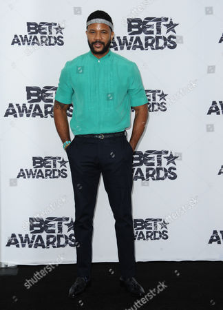 Hosea Chanchez poses in the press room at the BET Awards at the Microsoft Theater, in Los Angeles