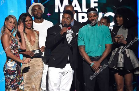 Brittany Daniel, from left, Wendy Raquel Robinson, Jay Ellis, Pooch Hall, Coby Bell, Barry Floyd, Hosea Chanchez, and Brandy Norwood present the award for best male hip hop artist at the BET Awards at the Microsoft Theater, in Los Angeles