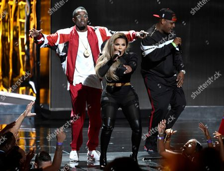 """Stock Picture of Sean """"Diddy"""" Combs, from left, Lil' Kim, and Sheek Louch perform at the BET Awards at the Microsoft Theater, in Los Angeles"""