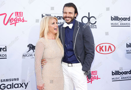 Britney Spears, left, and Charlie Ebersol arrive at the Billboard Music Awards at the MGM Grand Garden Arena, in Las Vegas