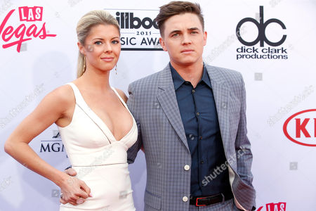 Katie Peterson, left, and Jesse McCartney arrive at the Billboard Music Awards at the MGM Grand Garden Arena, in Las Vegas