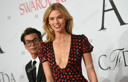 Model Karlie Kloss and Artistic Director of DVF Michael Herz arrive at the 2015 CFDA Fashion Awards at Alice Tully Hall, in New York