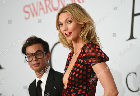 Stock Picture of Model Karlie Kloss and Artistic Director of DVF Michael Herz arrive at the 2015 CFDA Fashion Awards at Alice Tully Hall, in New York