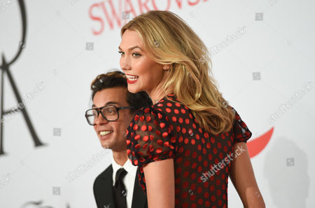Stock Photo of Model Karlie Kloss and Artistic Director of DVF Michael Herz arrive at the 2015 CFDA Fashion Awards at Alice Tully Hall, in New York