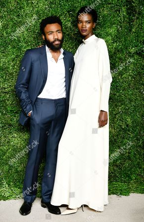 Actor Donald Glover, left, and Aamito Lagum attend the 12th Annual CFDA/Vogue Fashion Fund Awards at Spring Studios, in New York