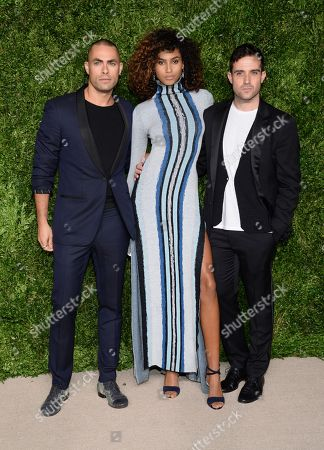 Model Imaan Hammam, center, and designers Scott Studenberg, left, and John Targon of Baja East attend the 12th Annual CFDA/Vogue Fashion Fund Awards at Spring Studios, in New York
