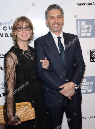 Katherine Borowitz, left, and John Turturro arrive at the 42nd annual Chaplin Award Gala honoring Robert Redford at Alice Tully Hall, in New York