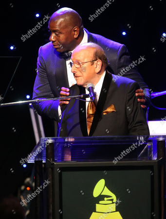 Earvin 'Magic' Johnson, left, and Clive Davis at the 2015 Clive Davis Pre-Grammy Gala show at the Beverly Hilton Hotel, in Beverly Hills, Calif