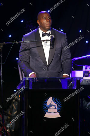 Earvin 'Magic' Johnson speaks on stage at the 2015 Clive Davis Pre-Grammy Gala show at the Beverly Hilton Hotel, in Beverly Hills, Calif