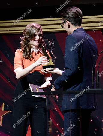 """Danielle Panabaker, left, presents Christopher Campbell, of Art Center College of Design, the 1st Place Commercial award for """"Maglite - Dreamweaver"""" at the 36th College Television Awards, presented by the Television Academy Foundation at the Skirball Cultural Center in Los Angeles on"""