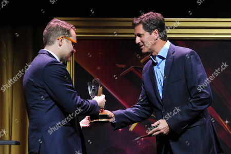 """Steven Levitan, from right, presents Trevor Worley, of American Film Institute, the 1st Place Comedy Award for """"Martian American"""" at the 36th College Television Awards, presented by the Television Academy Foundation at the Skirball Cultural Center in Los Angeles on"""