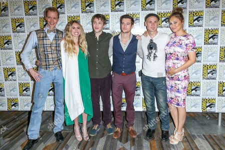 """From left, Doug Jones, Sarah Carter, Connor Jessup, Drew Roy, Colin Cunningham and Moon Bloodgood attend the """"Falling Skies"""" press line on day 2 of Comic-Con International, in San Diego"""