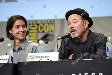 """Ruben Blades speaks during the """"Fear the Walking Dead"""" panel on day 2 of Comic-Con International, in San Diego, Calif. At left looking on is Lorenzo James Henrie"""