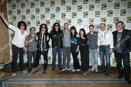 """From left, Tommy Thayer, Eric Singer, Paul Stanley, Gene Simmons, Matthew Lillard, Grey Griffin, Pauley Perrette, Kevin Shinick, Spike Brandt, and Tony Cervone attend the """"Scooby-Doo! and KISS: Rock and Roll Mystery"""" press line on day 1 of Comic-Con International, in San Diego"""