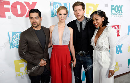 """Left to right, Wilmer Valderrama, Laura Regan, Stark Sands and Meagan Good, cast members in the television series """"Minority Report,"""" pose together at the Fox/FX/10th Century Fox TV/Fox International Channels Comic-Con Party, in San Diego, Calif"""