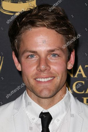 Lachlan Buchanan arrives at the 2015 Daytime Creative Arts Emmy Awards at The Universal Hilton, in Universal City, Calif