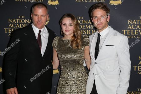 Sean Carrigan, from left, Hunter King and Lachlan Buchanan arrive at the 2015 Daytime Creative Arts Emmy Awards at The Universal Hilton, in Universal City, Calif