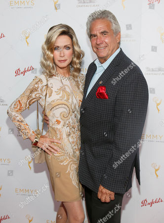 Stock Image of Donna Mills, left and Larry Gilman seen at the Television Academy's 67th Emmy Daytime Peer Group Celebration at the Montage Beverly Hills on in Beverly Hills, Calif