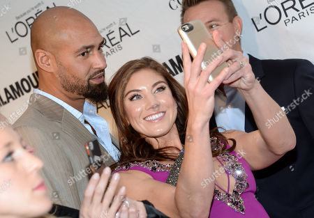 Stock Image of Jerramy Stevens, left, and Hope Solo take a selfie at the 25th annual Glamour Women of the Year Awards at Carnegie Hall, in New York