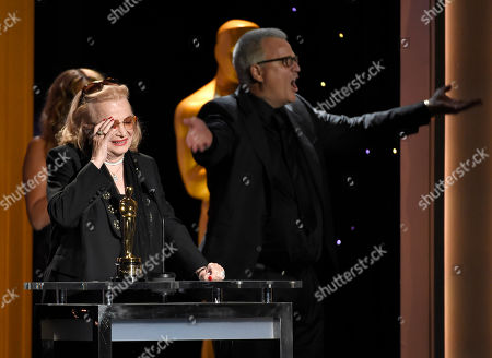 Gena Rowlands accepts an honorary Oscar at the Governors Awards at the Dolby Ballroom, in Los Angeles. Son, Nick Cassavetes, is seen at right