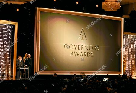 Gena Rowlands accepts an honorary Oscar at the Governors Awards at the Dolby Ballroom, in Los Angeles. Son, Nick Cassavetes, looks on from right