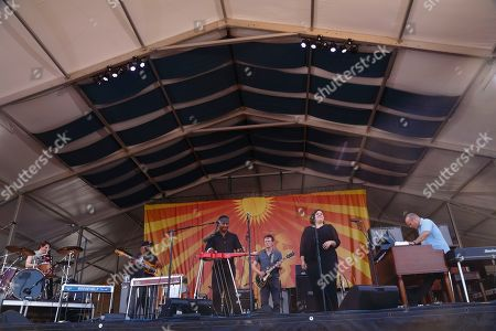 Cody Dickinson, Chris Chew, Robert Randolph, Luther Dickinson, special guest Jennifer Hartswick, John Medeski (left to right) of The Word performs at the New Orleans Jazz & Heritage Festival, in New Orleans, Louisiana