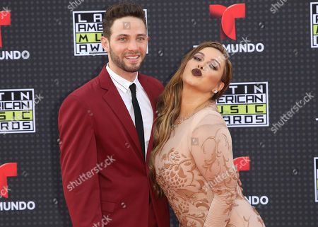 Stock Picture of Gabriel Coronel, left, and Chiquis Rivera arrive at the Latin American Music Awards at the Dolby Theatre, in Los Angeles