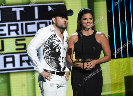 Roberto Tapia, left, and Rashel Diaz introduce a performance by CD9 at the Latin American Music Awards at the Dolby Theatre, in Los Angeles
