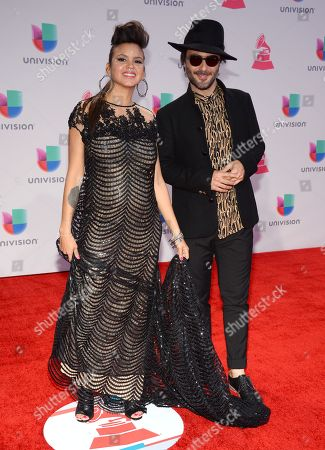Liliana Saumet, left, and Simon Mejia, of Bomba Estereo, arrive at the 16th annual Latin Grammy Awards at the MGM Grand Garden Arena, in Las Vegas