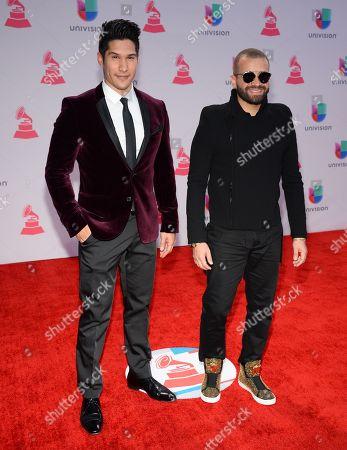 Jesus Alberto Miranda Perez, left, and Miguel Ignacio Mendoza Donatti, of Chino & Nacho, arrive at the 16th annual Latin Grammy Awards at the MGM Grand Garden Arena, in Las Vegas