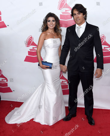 Paula Fernandes, left, and Henrique do Valle arrive at the Latin Recording Academy Person of the Year Tribute honoring Roberto Carlos at the Mandalay Bay Convention Center, in Las Vegas
