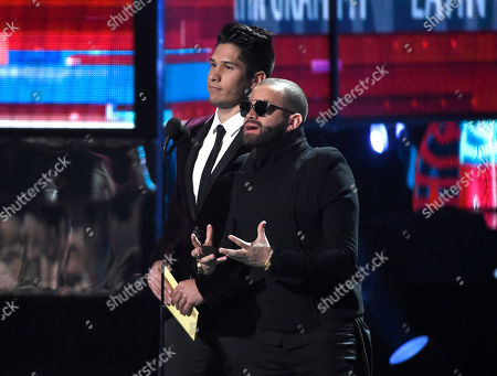 Jesus Alberto Miranda Perez, left, and Miguel Ignacio Mendoza, of Chino & Nacho present the award for song of the year at the 16th annual Latin Grammy Awards at the MGM Grand Garden Arena, in Las Vegas