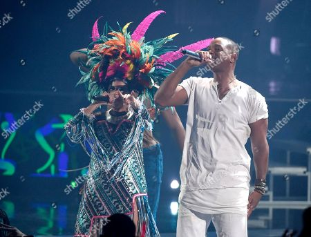 """Liliana Saumet, left, of Bomba Estereo, and Will Smith perform """"Fiesta"""" at the 16th annual Latin Grammy Awards at the MGM Grand Garden Arena, in Las Vegas"""